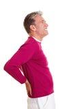 Homme aîné avec douleur dorsale Photos libres de droits