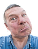Homme aîné avec l'expression maladroite Photos libres de droits