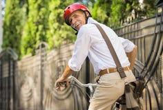 Homme aîné avec la bicyclette Images libres de droits