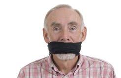 Homme aîné avec le bâillon au-dessus de la bouche Image stock