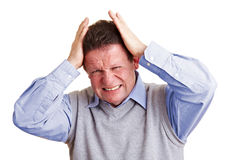 Homme aîné avec le mal de tête Photos stock