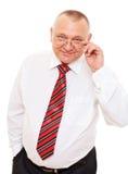 Homme aîné d'affaires au-dessus du fond blanc Photographie stock