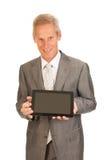 Homme aîné d'affaires avec la tablette Photographie stock libre de droits