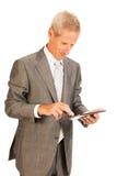 Homme aîné d'affaires avec la tablette Photographie stock