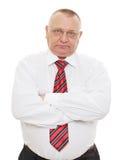 Homme aîné d'affaires avec les bras croisés Image libre de droits