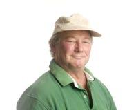 Homme aîné de Moyen Âge s'usant le sourire occasionnel de chapeau Photographie stock