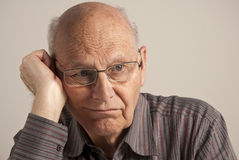 Homme aîné ennuyé Photographie stock