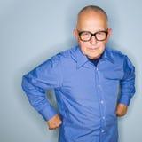 Homme aîné fâché dans des lunettes Photographie stock