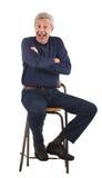 Homme aîné heureux avec des bras croisés Photos libres de droits