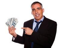 Homme aîné hispanique d'affaires avec des dollars Photo libre de droits