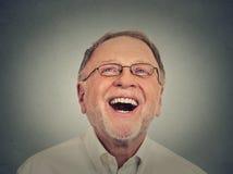 Homme aîné riant Images libres de droits