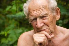 Homme aîné songeur Images stock