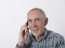 Homme aîné sur le portable Photographie stock
