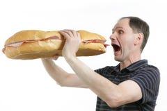 Homme affamé Photographie stock libre de droits