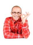 Homme affichant l'approbation d'isolement sur le blanc photos stock