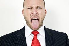 Homme affichant la langue Photo stock