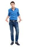 Homme affichant les poches vides Photographie stock libre de droits