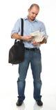 Homme affichant un livre Photographie stock libre de droits