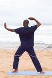 Homme africain faisant le chi de tai Image libre de droits