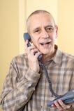 Homme amical au téléphone Image stock