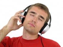 Homme appréciant la musique Image libre de droits