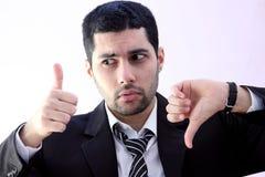 Homme arabe confus d'affaires avec le coup haut et le coup vers le bas Photos stock