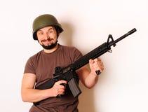 Homme armé fol Image libre de droits