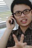 Homme asiatique avec le téléphone photo libre de droits