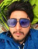 Homme asiatique bel avec la pose de barbe Photographie stock libre de droits