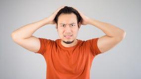 Homme asiatique déçu Images stock
