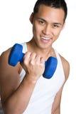 Homme asiatique de séance d'entraînement Image stock
