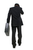 Homme attirant d'affaires dans le procès rayé de Pin et chapeau marchant loin Photo stock