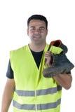 Homme attirant dans des vêtements et des chaussures de travail Images stock