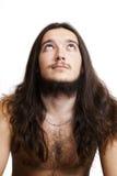 Homme aux cheveux longs et barbu recherchant Image stock
