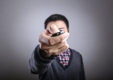 Homme avec à télécommande Photo stock
