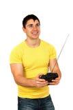 Homme avec à télécommande par radio Photo stock