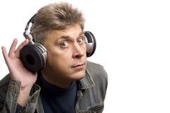 Homme avec des écouteurs Photos libres de droits