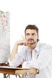 Homme avec des brosses et la séance de palette D'isolement au-dessus du blanc photos stock