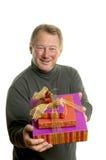 Homme avec des cadeaux Photographie stock libre de droits