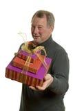 Homme avec des cadeaux photo stock