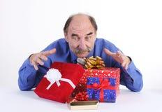 Homme avec des cadeaux photos stock