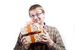 Homme avec des cadeaux de Noël Image libre de droits