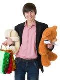 Homme avec des cadeaux et par la carte de crédit Image libre de droits
