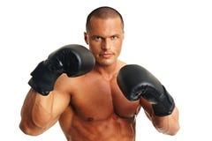 Homme avec des gants de boxeur Photos stock