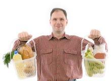 Homme avec des nourritures Photo libre de droits