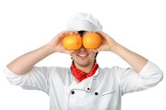 Homme avec des oranges image stock