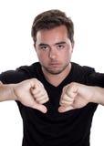 Homme avec des pouces vers le bas Photos libres de droits