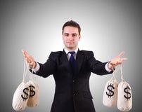 Homme avec des sacs à argent sur le blanc Photos libres de droits