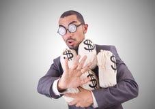 Homme avec des sacs à argent sur le blanc Photographie stock