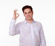 Homme avec du charme avec le sourire correct de geste Photographie stock libre de droits